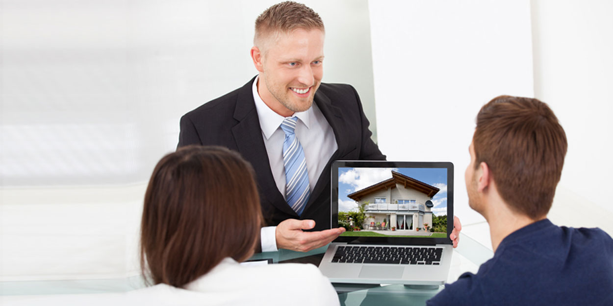 Real Estate agent with customers.